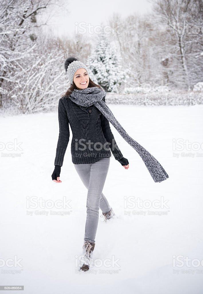 Woman enjoying this beautiful snowy Winterday stock photo