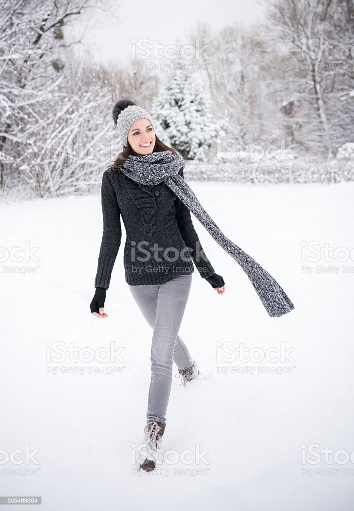 Woman enjoying this beautiful snowy Winterday stock photo