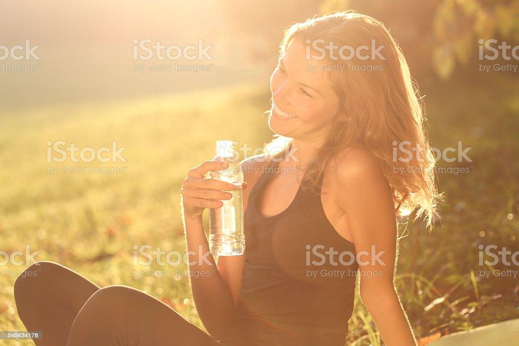 Woman enjoying time in park stock photo