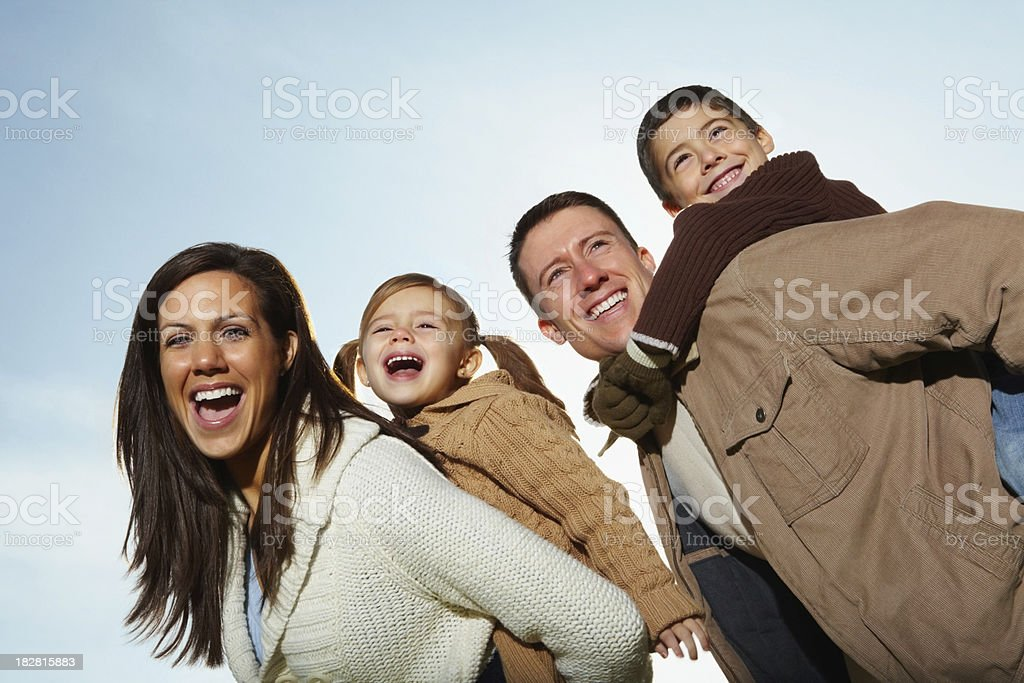 Woman enjoying vacation with her kids and husband royalty-free stock photo
