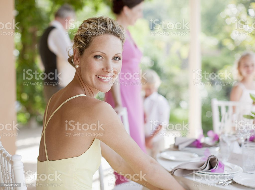 Woman enjoying wedding reception stock photo