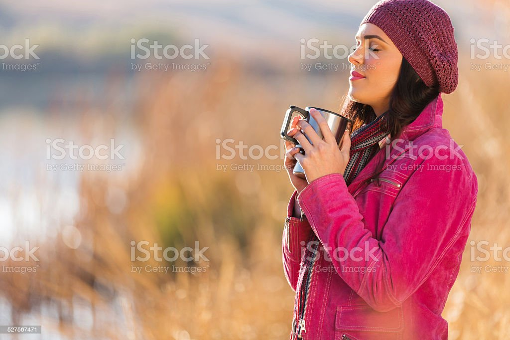woman enjoying winter morning outdoors stock photo
