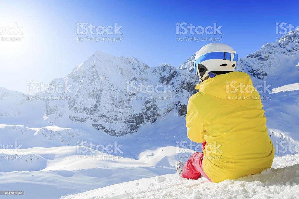 Woman enjoying winter on ski vacation stock photo
