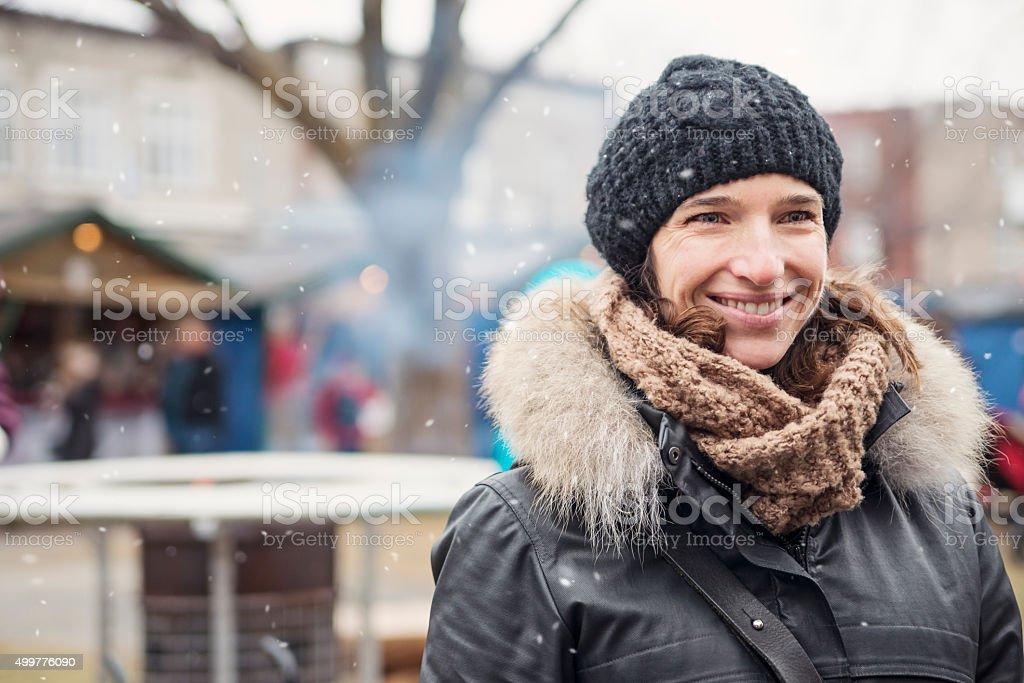 Woman enjoying winter season, outdoors in city public park. stock photo