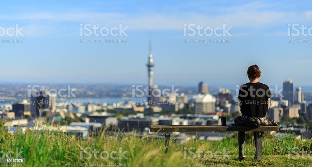 Woman enjoys spectacular morning views of Auckland city stock photo