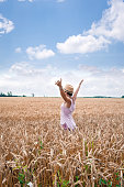 Woman enjoys the immensity chain with ripe wheat