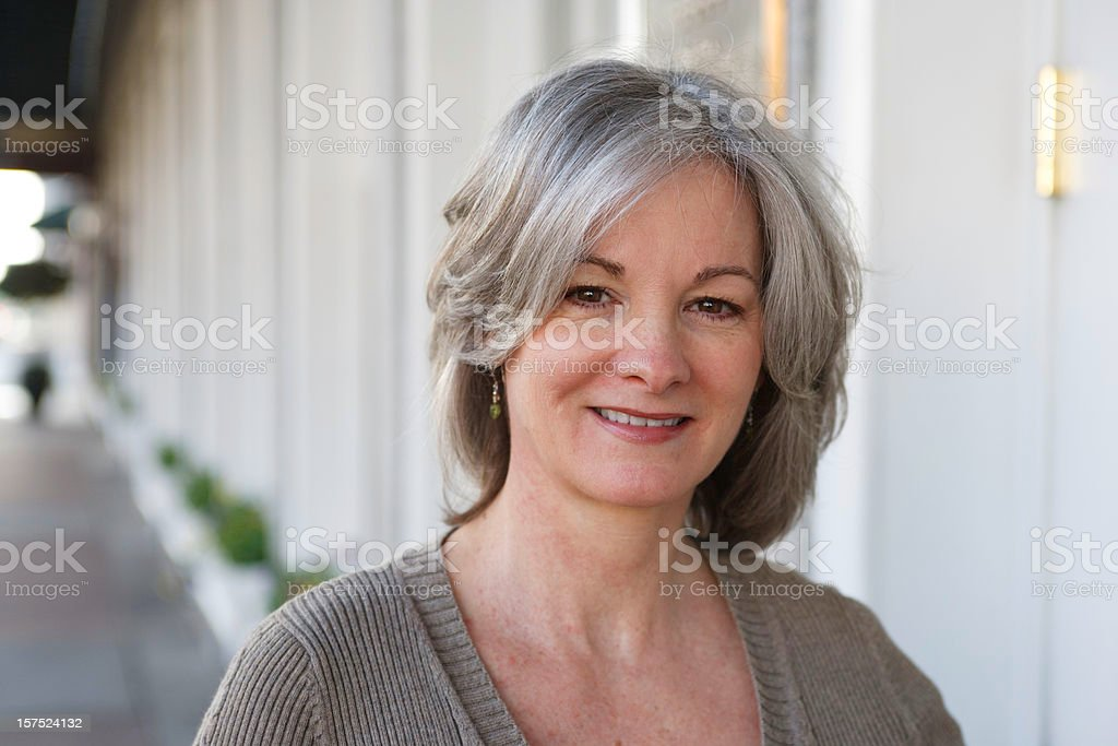Woman entering hotel royalty-free stock photo