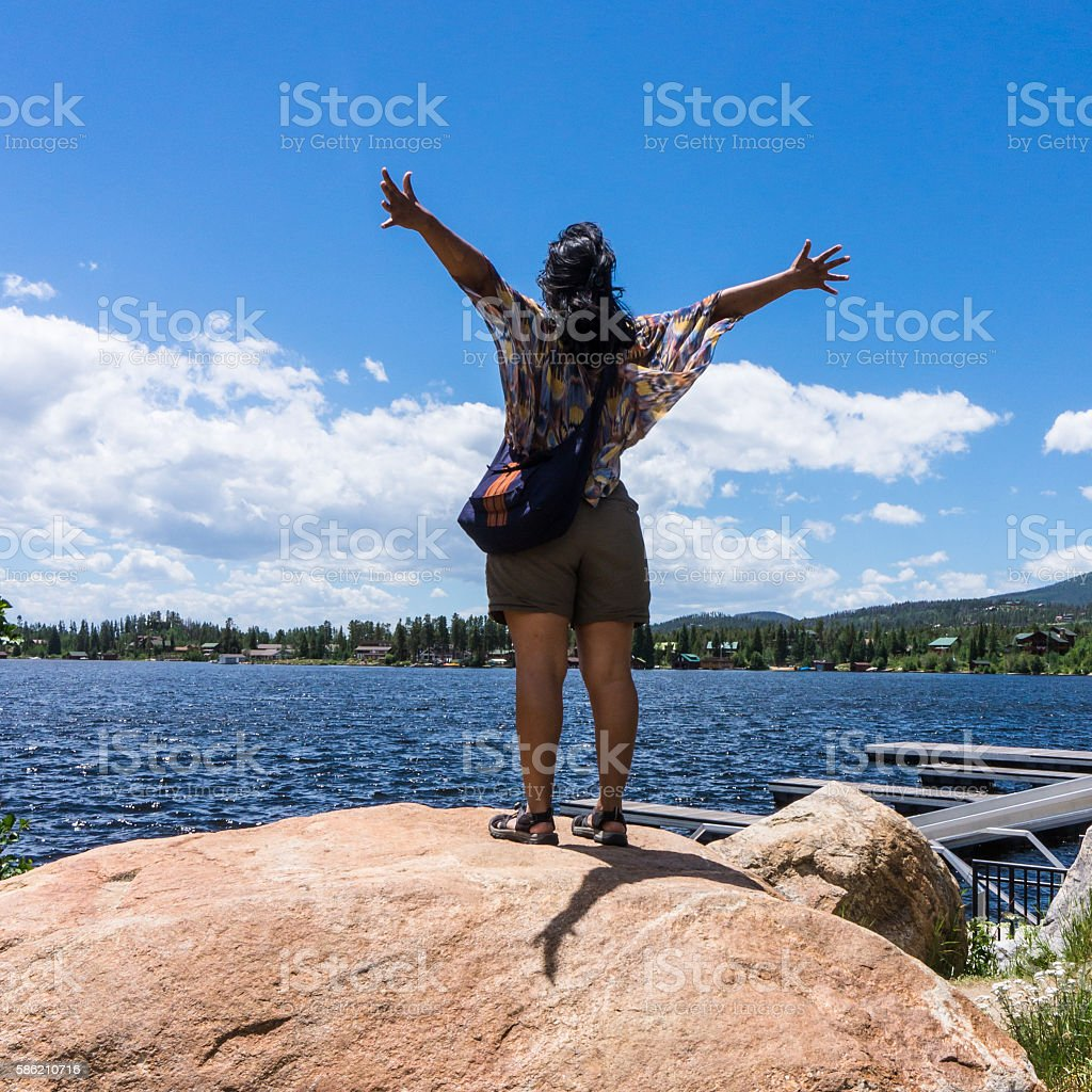 woman enthusiastically embracing a summer day stock photo