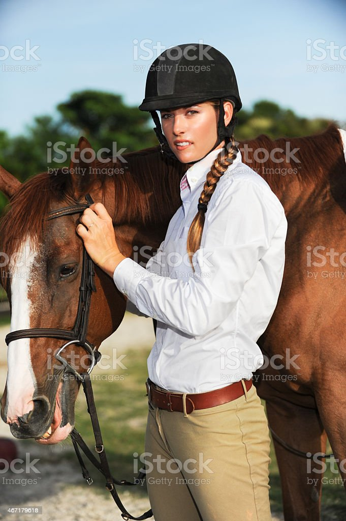 Woman Equestrian with Chestnut Mare Horse on Ranch stock photo