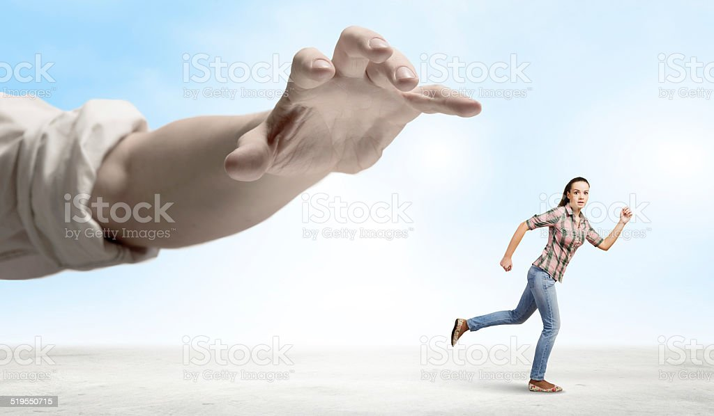 Woman escape from hand stock photo