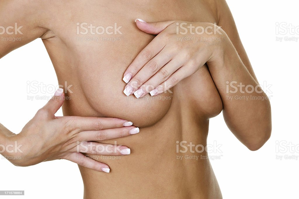 Woman examining her breast for cancer royalty-free stock photo
