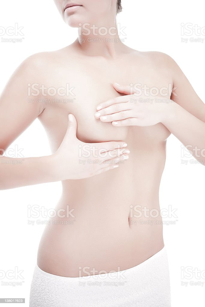 Woman examining her breast isolated on white royalty-free stock photo