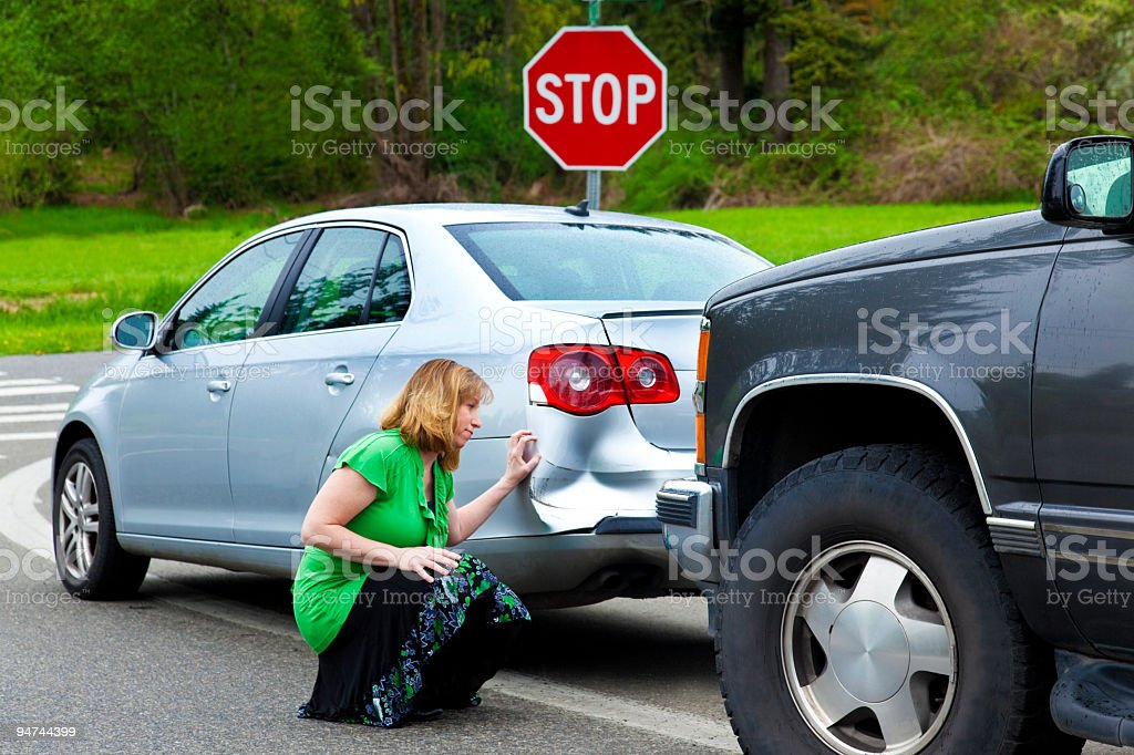 Woman Examining the Car Damage royalty-free stock photo