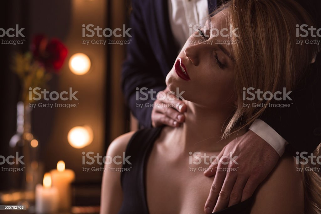 Woman excited by man's touch stock photo