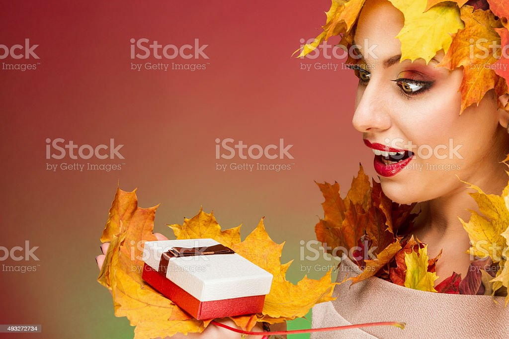 Woman excited looking at gift royalty-free stock photo