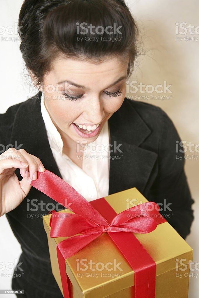 Woman Excited To Open Up Her Gift royalty-free stock photo