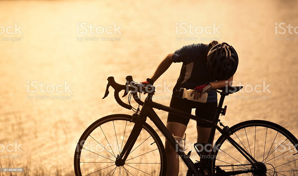 Woman exercise bike She felt tired And relaxing drink stock photo