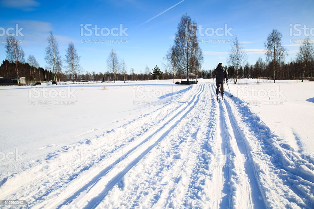 woman exercise by cross country skiing on a golf cource stock photo