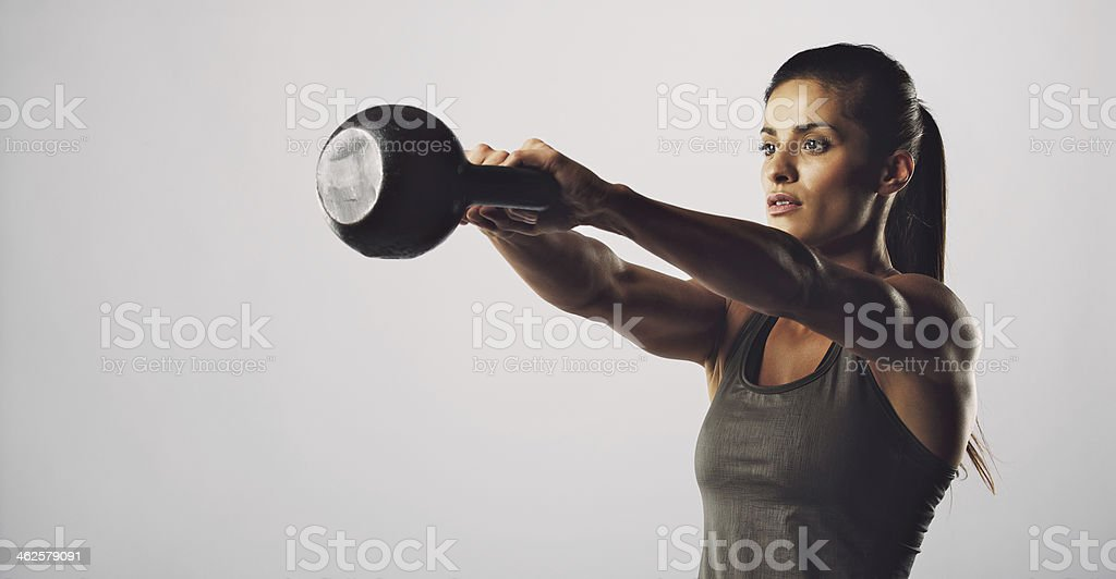Woman exercise with kettle bell - Crossfit workout stock photo