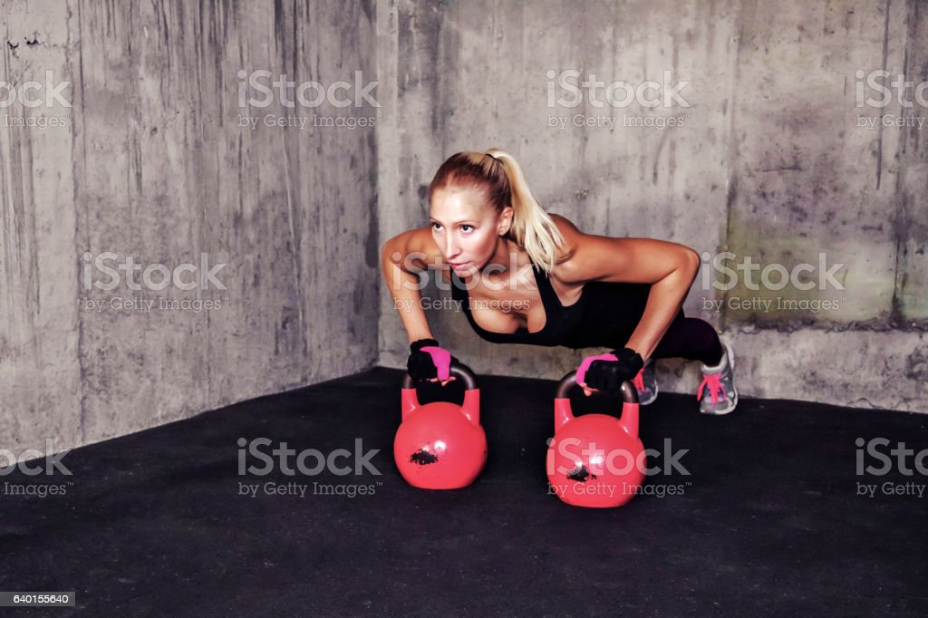 Woman exercise with kettle bell - gym workout stock photo