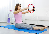 Woman Exercise With Pilates Ring.
