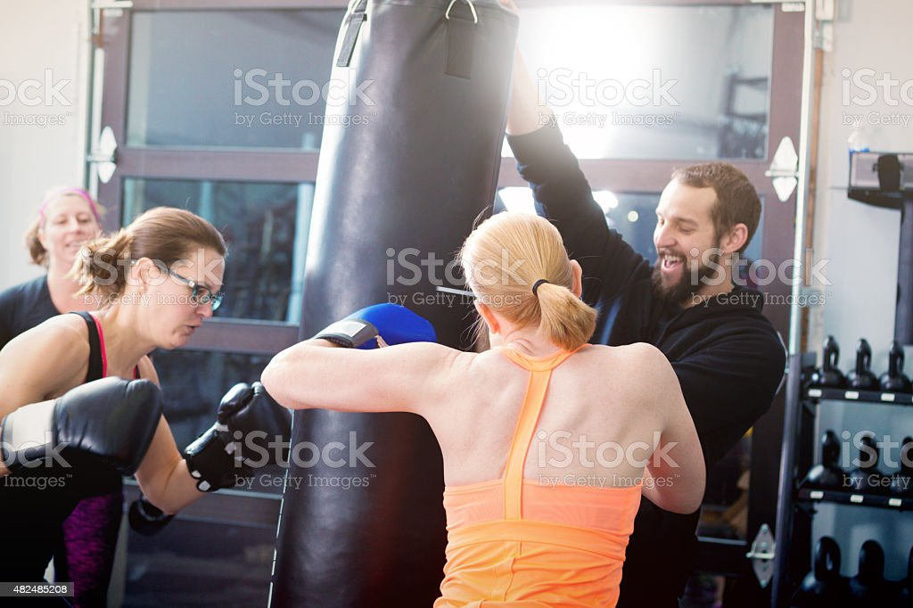 Woman Exercise Workout Boxing in Health Club Facility stock photo