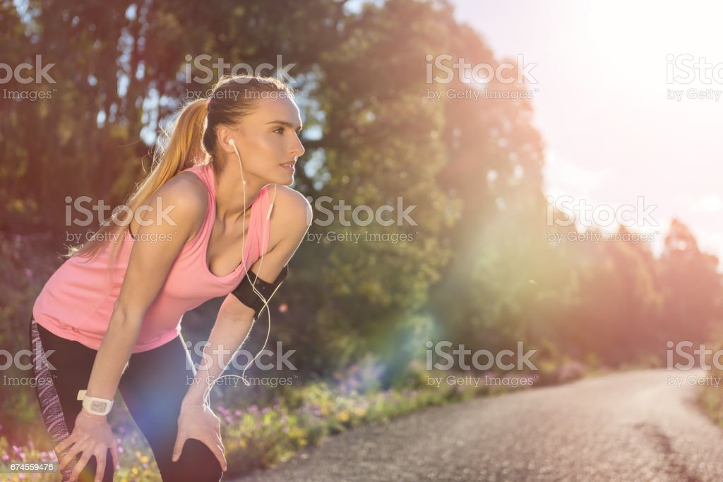 Woman exercising and taking a break stock photo