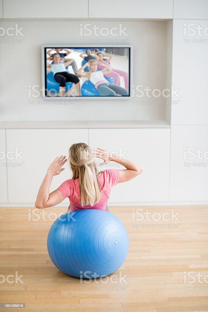 Woman exercising at home stock photo