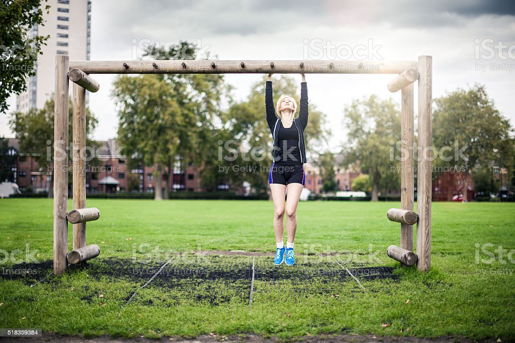Woman exercising at the park in London stock photo