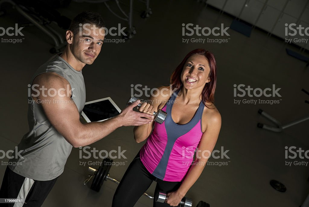 woman exercising fitness man coach using digital tablet royalty-free stock photo