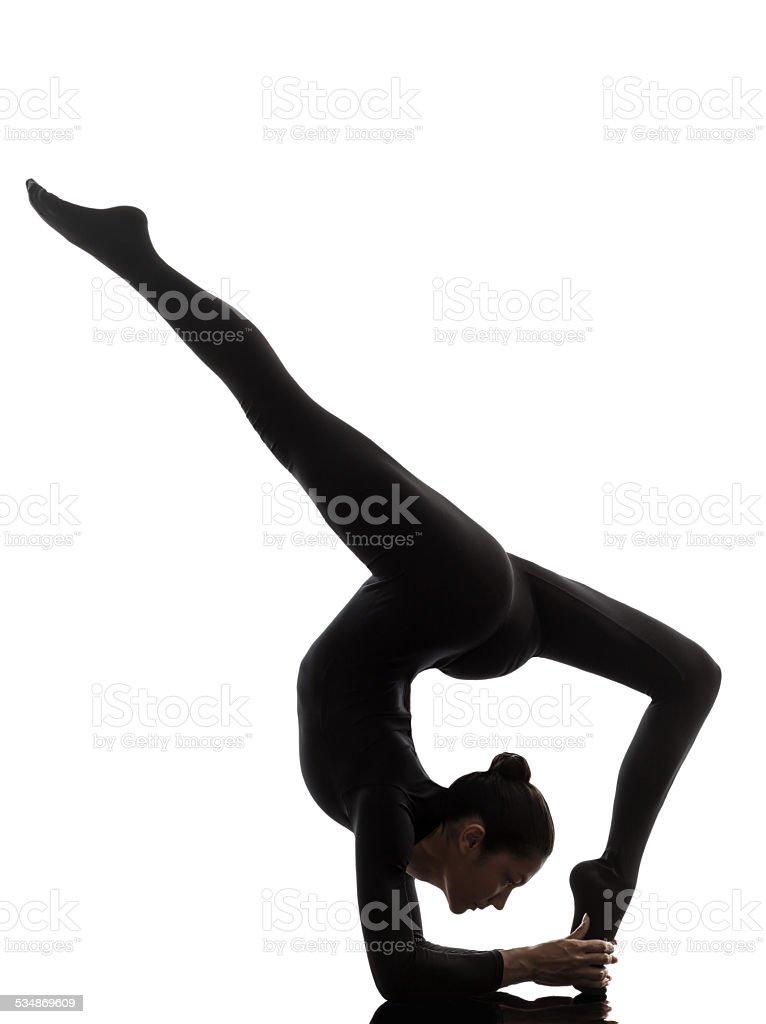 woman exercising gymnastic yoga  Eka Pada Viparita Dandasana sil stock photo
