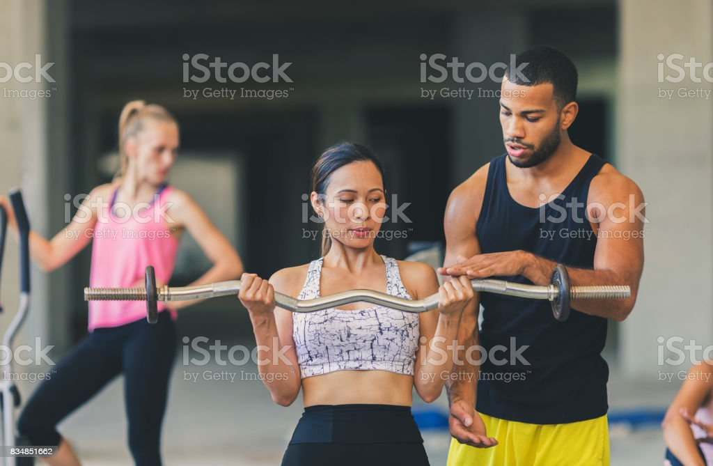 Woman exercising in an urban gym stock photo
