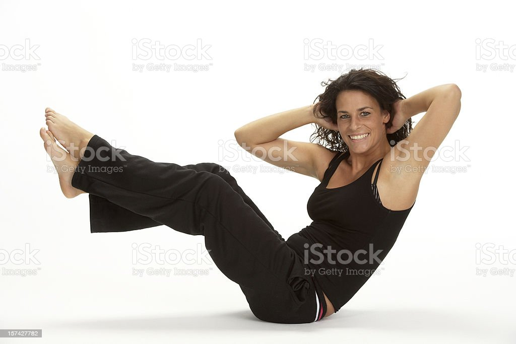 Woman exercising in fitness studio royalty-free stock photo