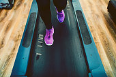 Woman Exercising In Gym On Treadmill.