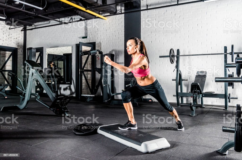 Woman exercising in gym stock photo