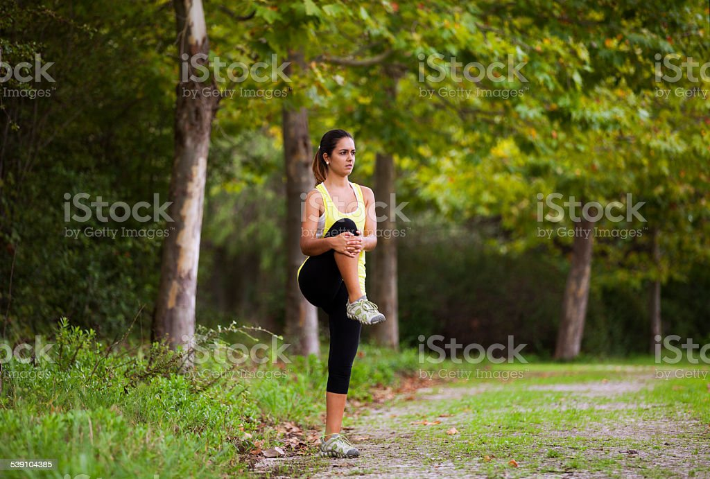 Woman exercising in outdoor stock photo