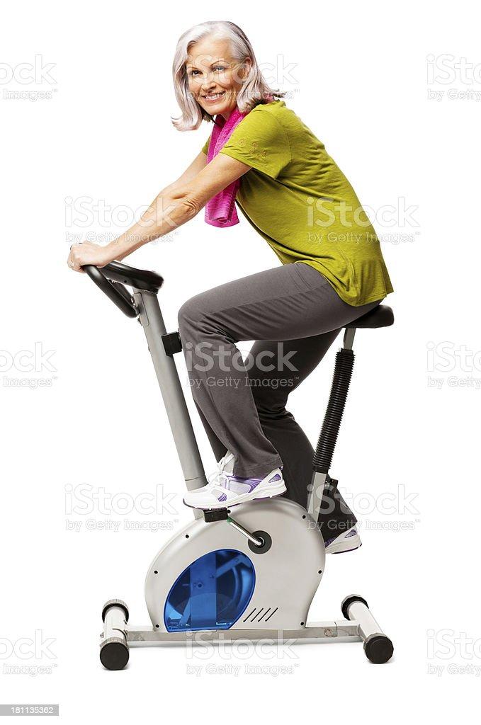 Woman Exercising On Exercise Bike - Isolated royalty-free stock photo