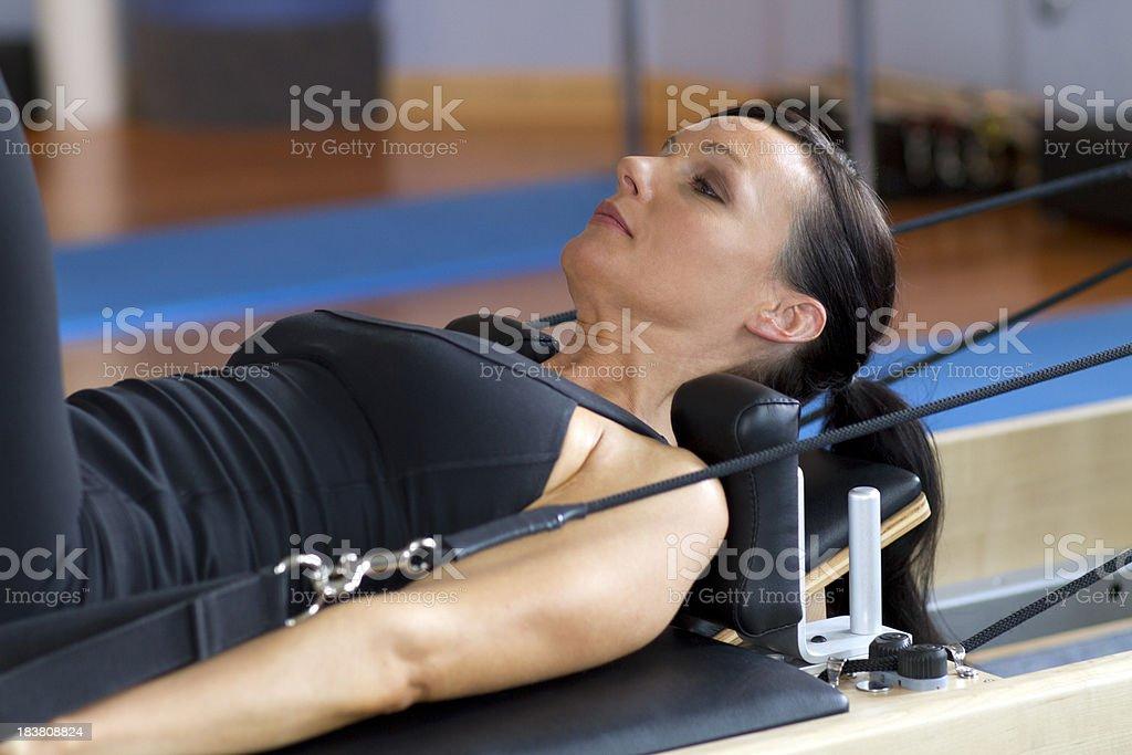 Woman Exercising on Pilates Reformer royalty-free stock photo