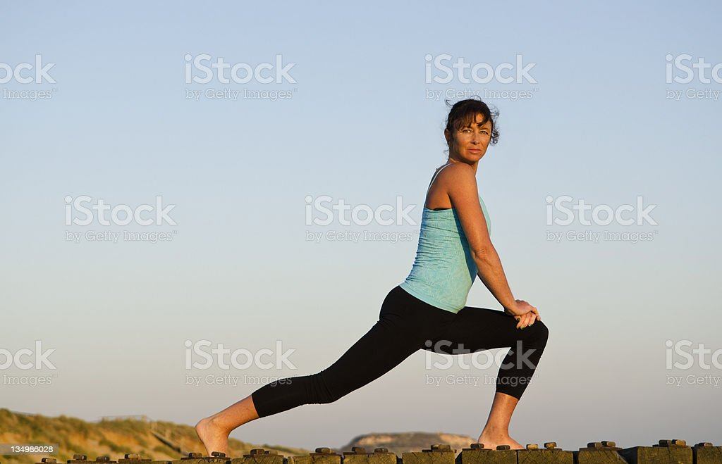 woman exercising on the beach. royalty-free stock photo