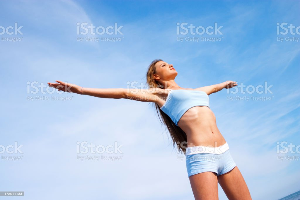 Woman exercising on the beach royalty-free stock photo