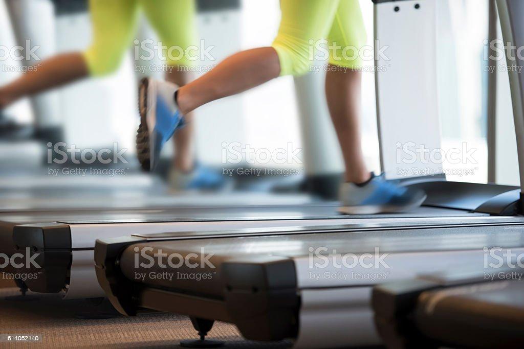 Woman exercising on treadmill stock photo