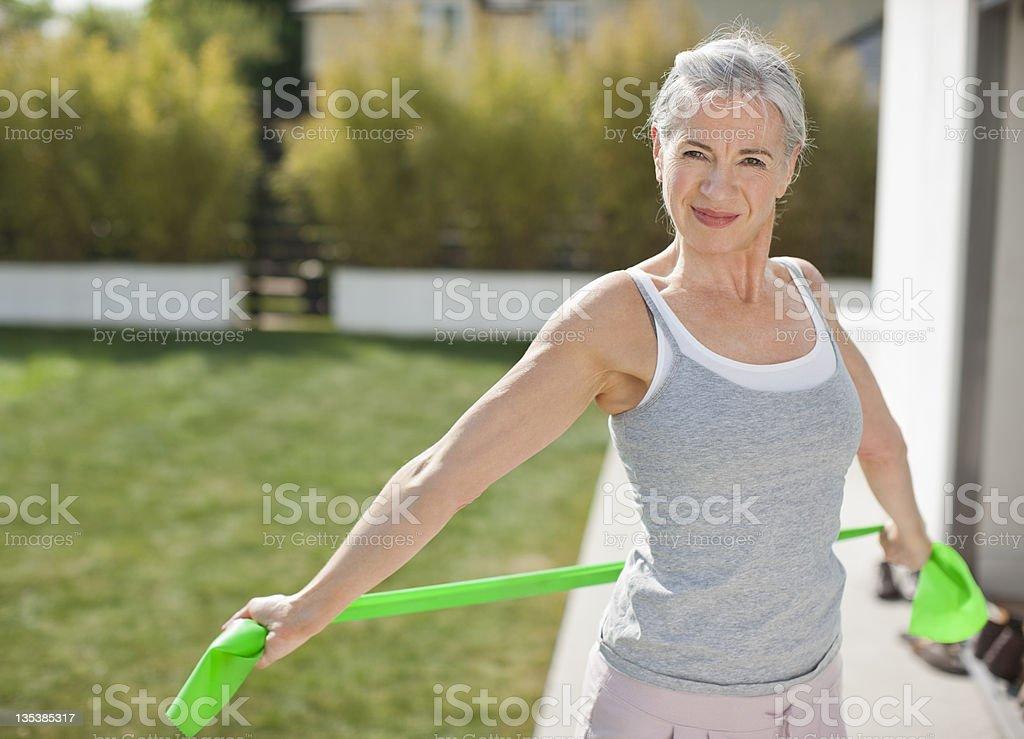 Woman exercising outdoors stock photo