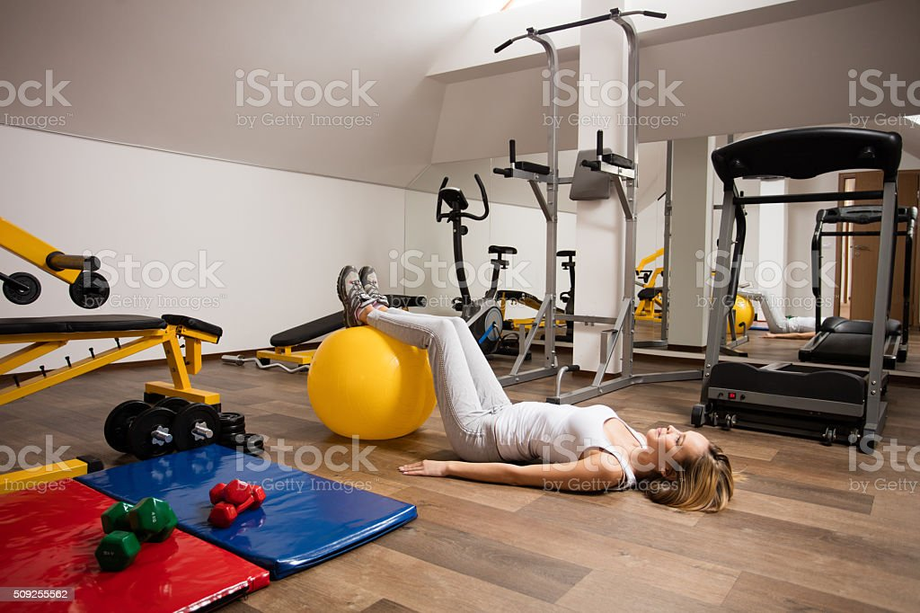 Woman exercising pilates in the gym stock photo
