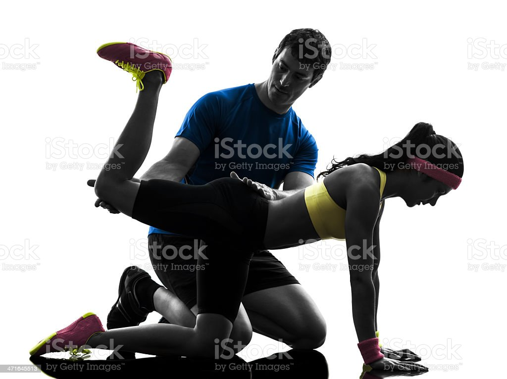 woman exercising plank position fitness workout with man coach royalty-free stock photo