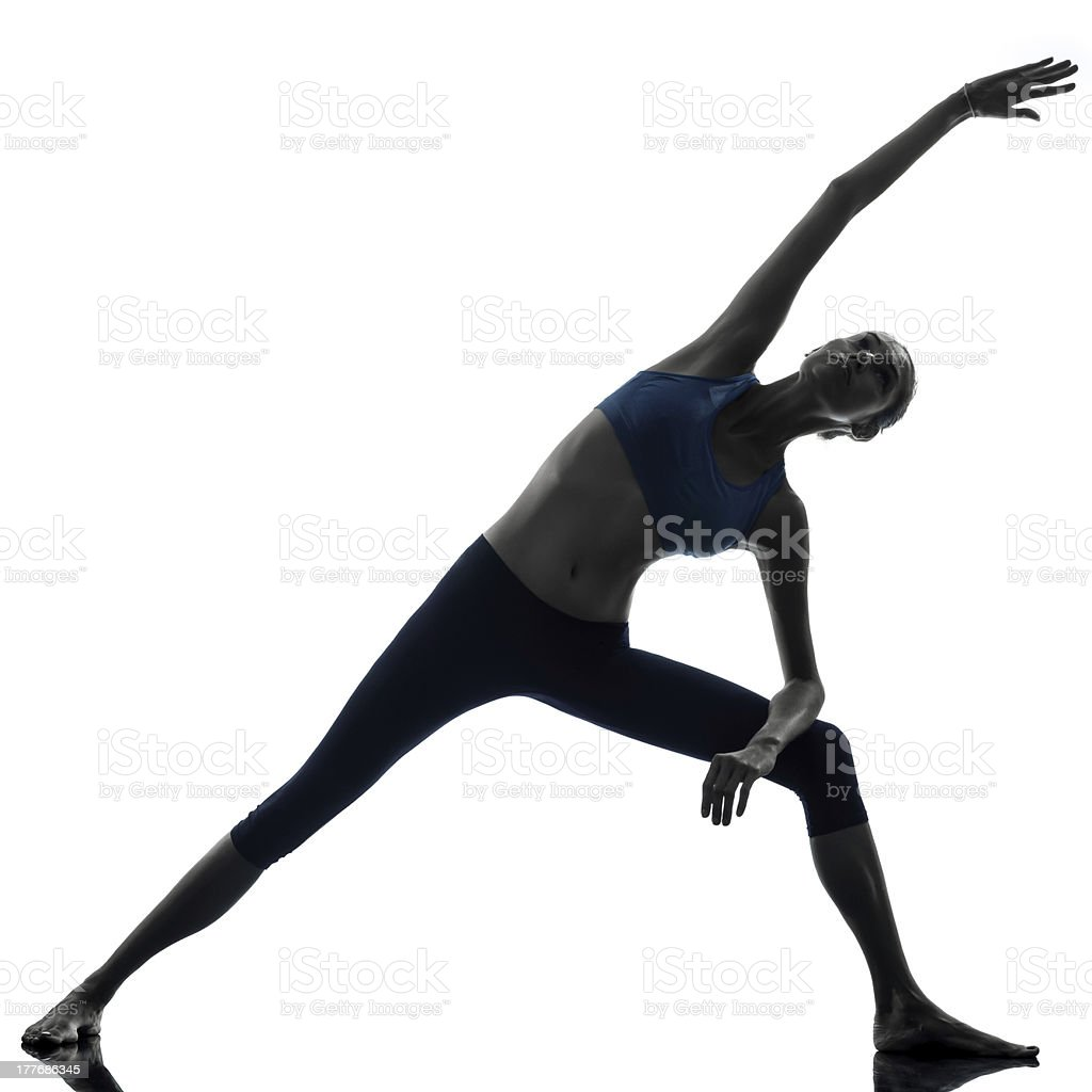 woman exercising stretching triangle pose yoga royalty-free stock photo