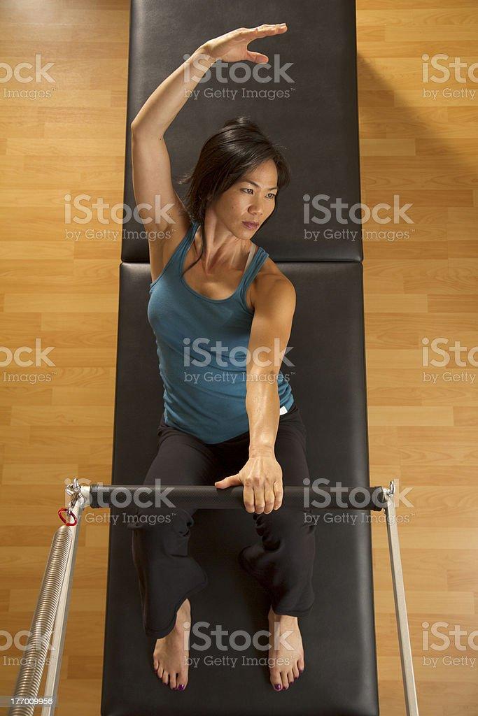 Woman Exercising - Trapeze Table stock photo
