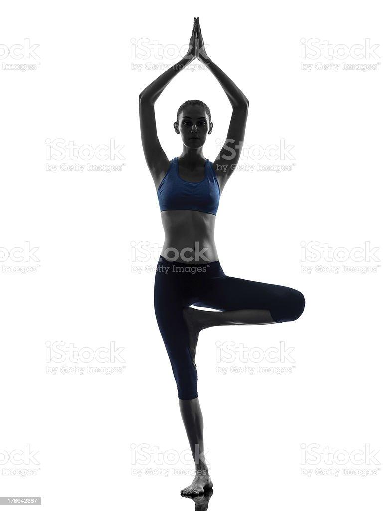 woman exercising tree pose yoga stock photo