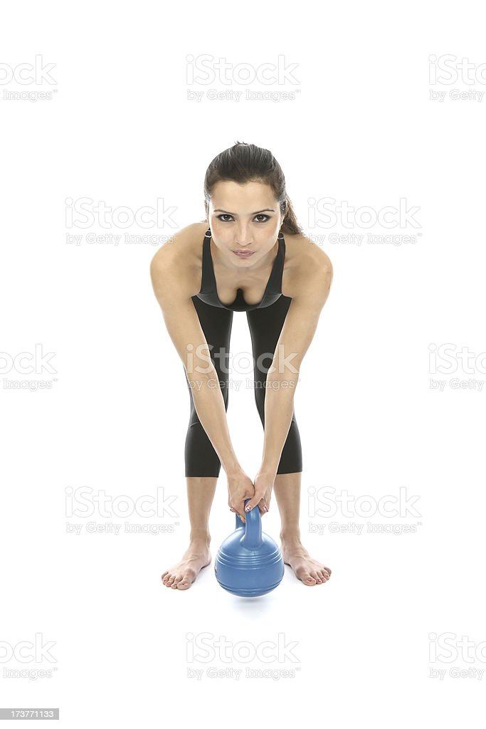 Woman Exercising Using Kettle Bell Weight stock photo
