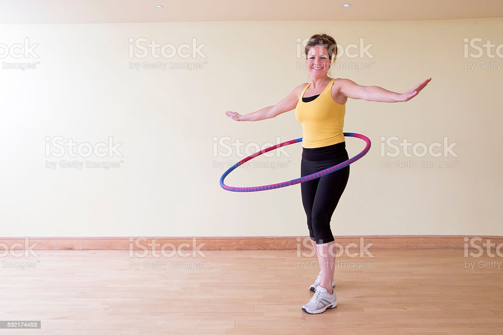 Woman Exercising With A Hula Hoop stock photo