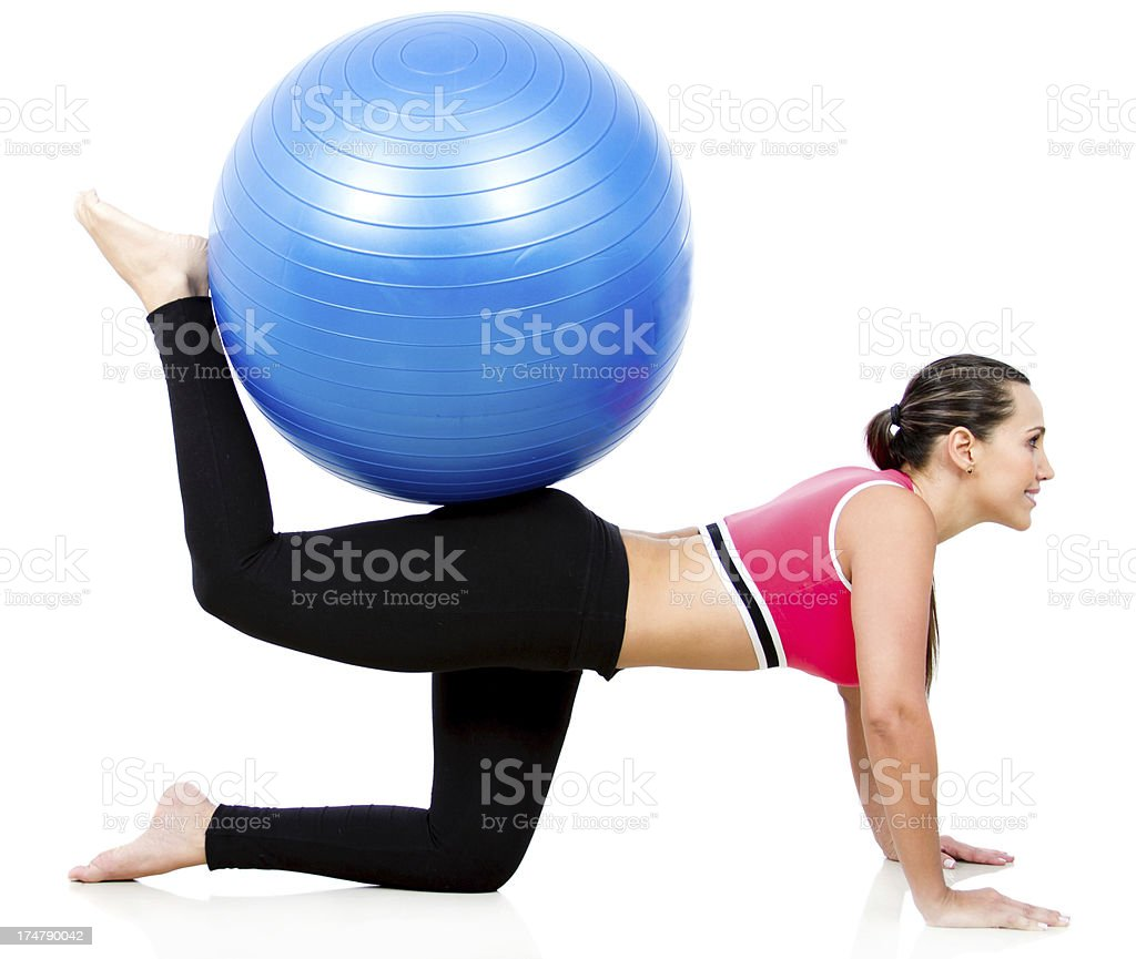 Woman exercising with a Swiss ball royalty-free stock photo